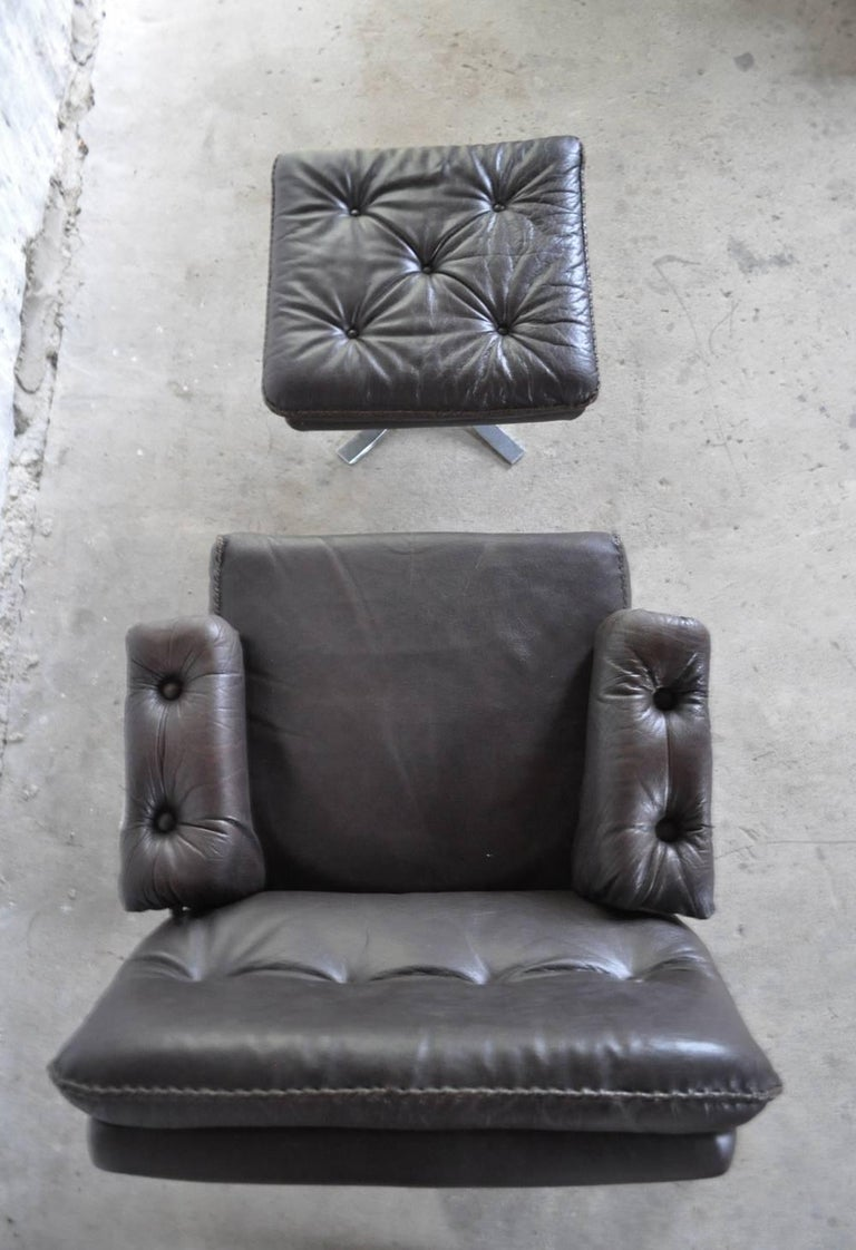 Scandinavian Modern Dark Brown Leather and Chrome Lounge Chair and Stool by Arne Norell For Sale