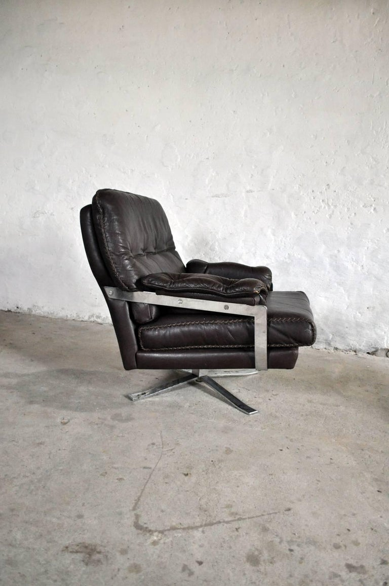 Norwegian Dark Brown Leather and Chrome Lounge Chair and Stool by Arne Norell For Sale