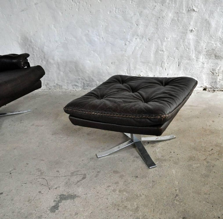 Dark Brown Leather and Chrome Lounge Chair and Stool by Arne Norell For Sale 1