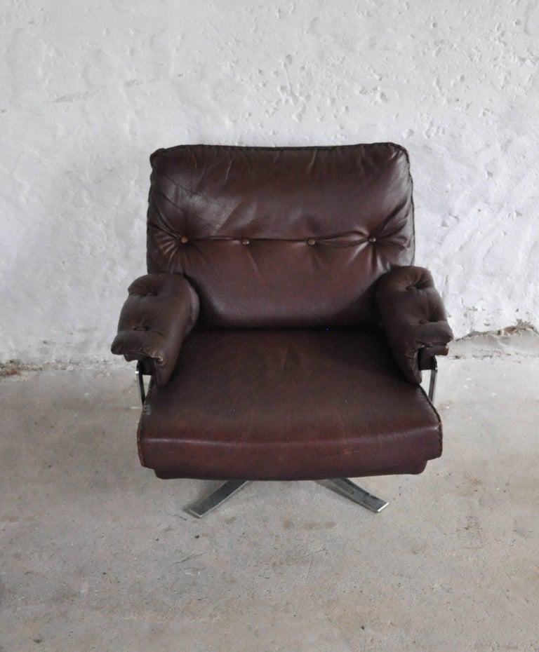Scandinavian Modern Reddish Brown Leather and Chrome Lounge Chair and Stool by Arne Norell For Sale