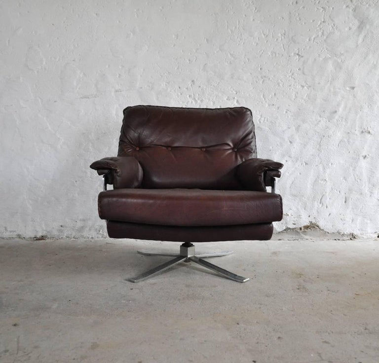 Norwegian Reddish Brown Leather and Chrome Lounge Chair and Stool by Arne Norell For Sale