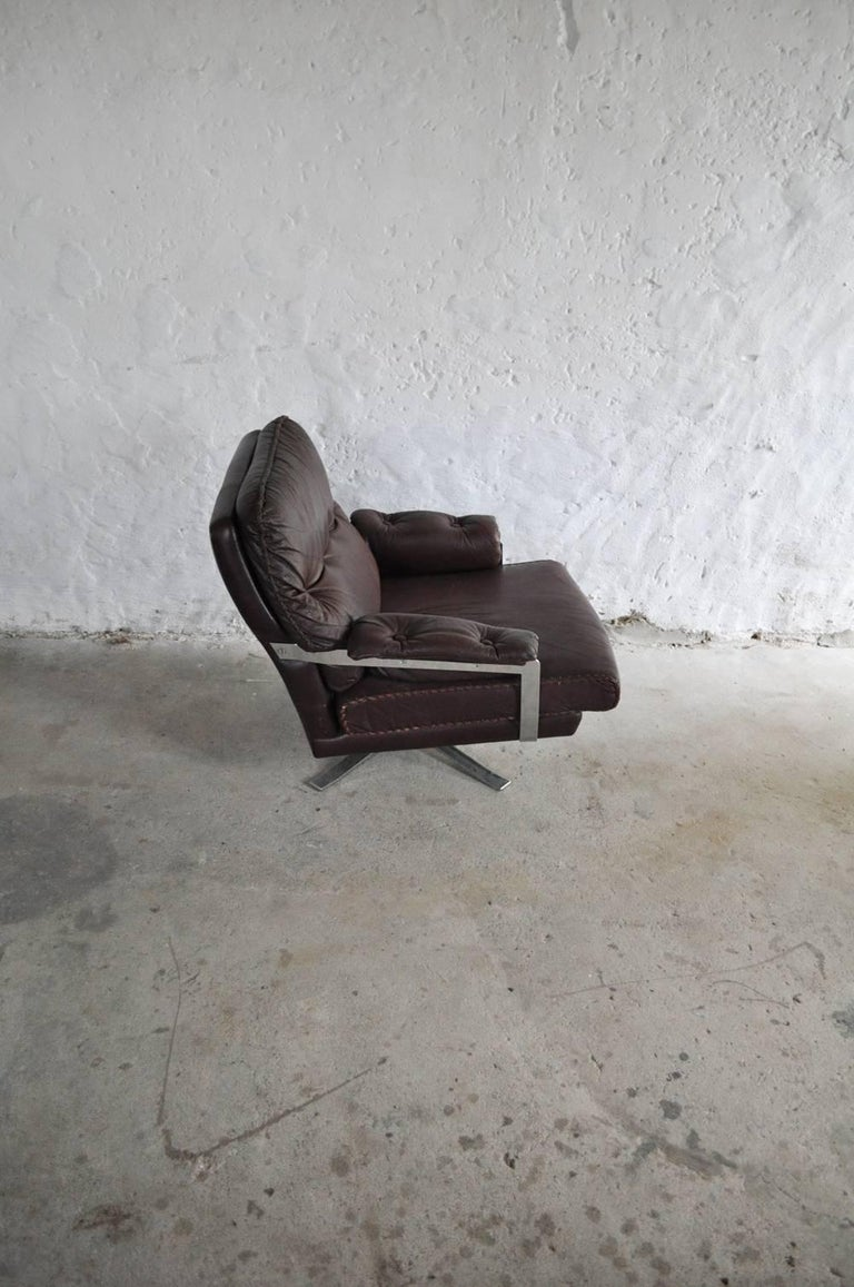 Mid-20th Century Reddish Brown Leather and Chrome Lounge Chair and Stool by Arne Norell For Sale