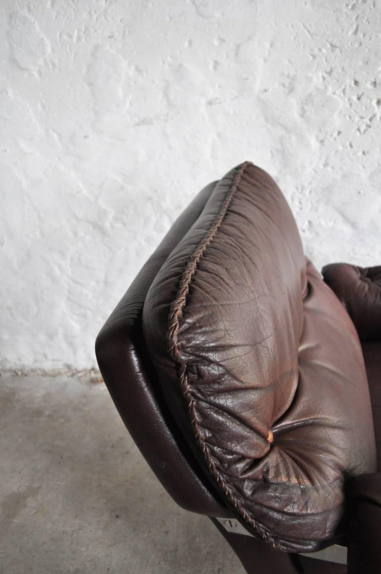 Reddish Brown Leather and Chrome Lounge Chair and Stool by Arne Norell For Sale 2