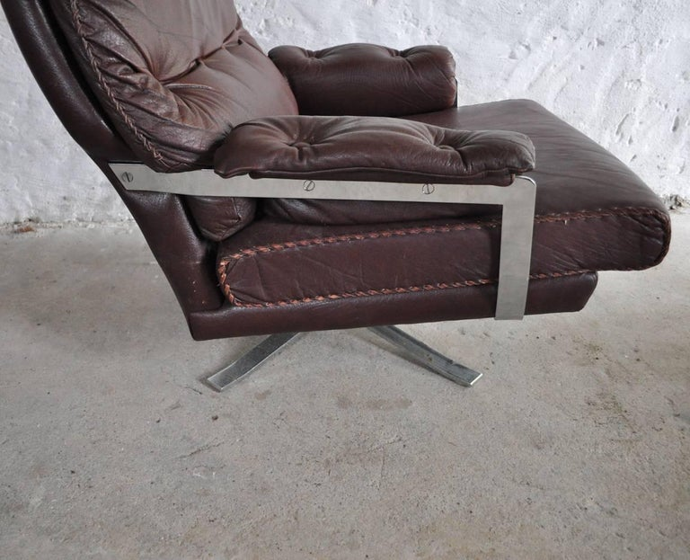 Reddish Brown Leather and Chrome Lounge Chair and Stool by Arne Norell For Sale 3