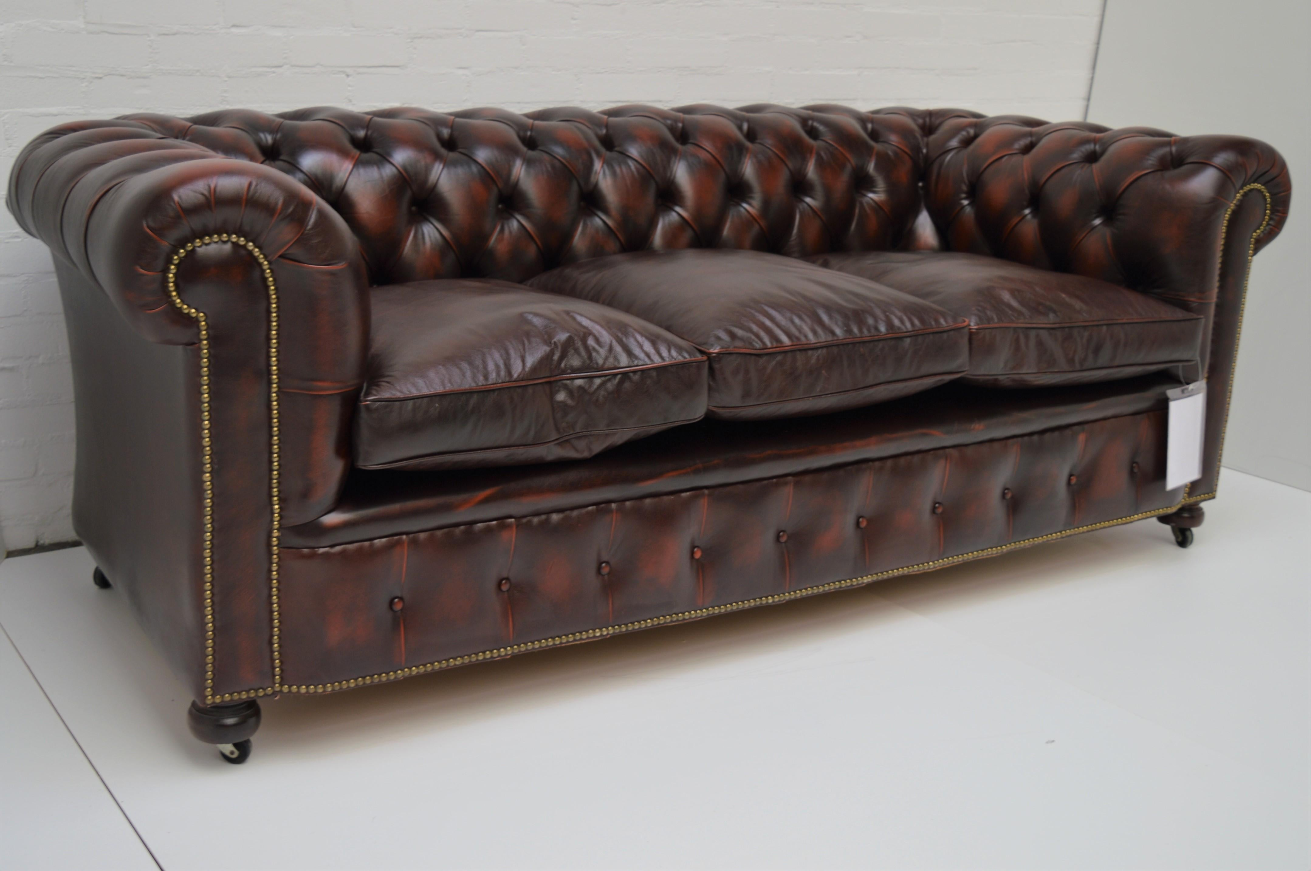 English Antique Tan Chesterfield Sofa With Brass Castors / Wheels For Sale