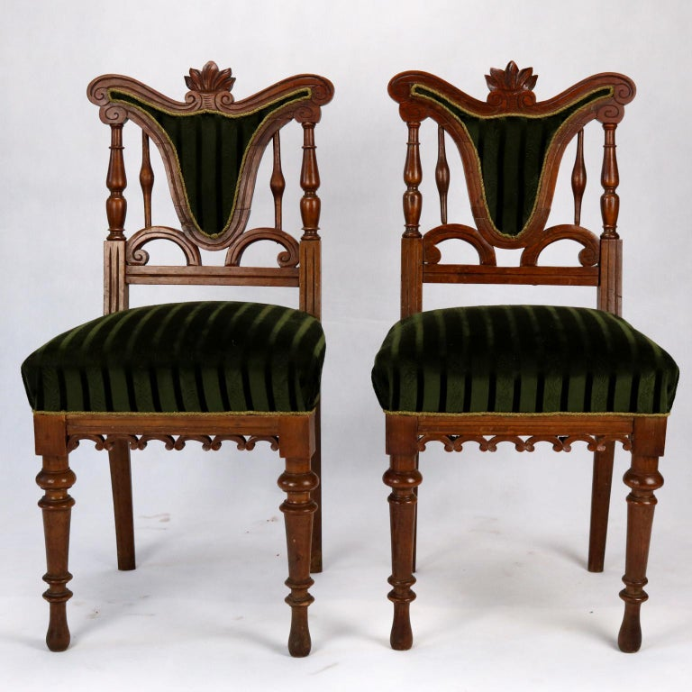 Pair of carved side chairs from late 19th century.