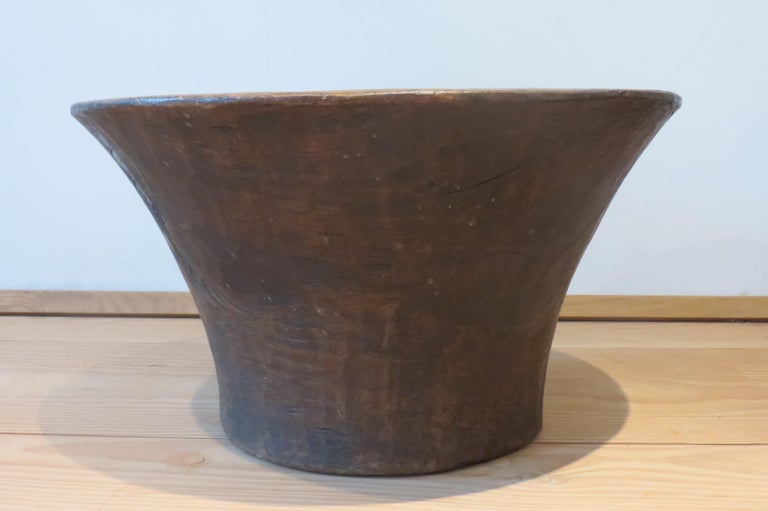 A very large African wooden bowl. Made from African hardwood and dates from the mid 20th Century. Measures 49cm diameter x 28cm tall.