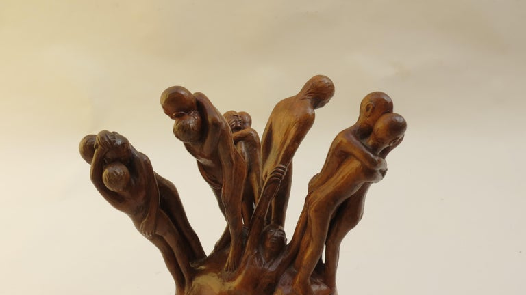 Sculptural carving, by Thomas de la Berthauche, depicting figures reuniting. Organic form, in lime wood.