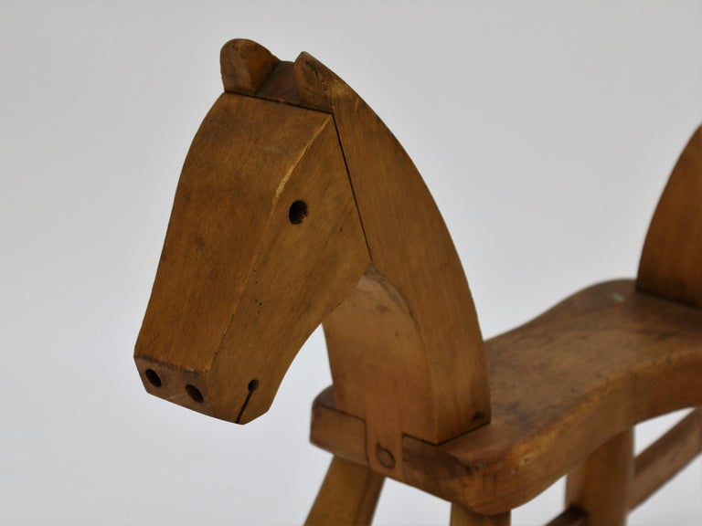 One of Danish designer Kay Bojensen´s most famous designs is this toy rocking horse in beech from 1936. The design has been altered through the years, but it remains in production to this day. This is the earliest and original design without the