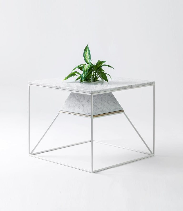 A Russian spacecraft provided the inspiration for Supaform's 'Sputnik 5' marble coffee table, which doubles as a vessel for growing plants or shrubs.
