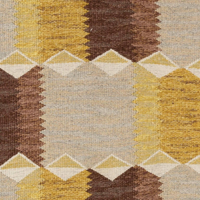 Classic and vintage Scandinavian modern at it best. Pattern with beautiful tonal grey, warm yellow and ivory melange ground with rows of whimsical and polychrome geometric shapes. Signed and handwoven in Anna greta Sjöqvist's atelier in Sösdala in