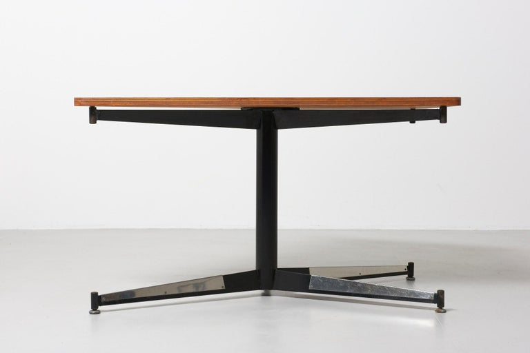 A table designed by Willy Van Der Meeren for the HBK Bank Building in Antwerp. The diamond shaped tabletop is multiplex with walnut veneer, and supported by a black lacquered frame with folded sheets of steel.
