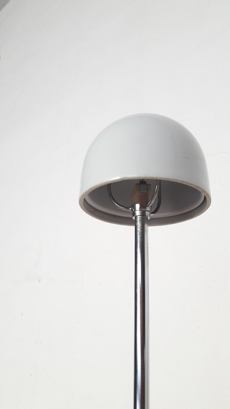 'Nemea' a very original table lamp by Vico Magistretti, designed for Artemide in 1979. The parabola-shade is generated from a conical segment template cut in half, the design plays on the relationship between the circular disk base and a very small