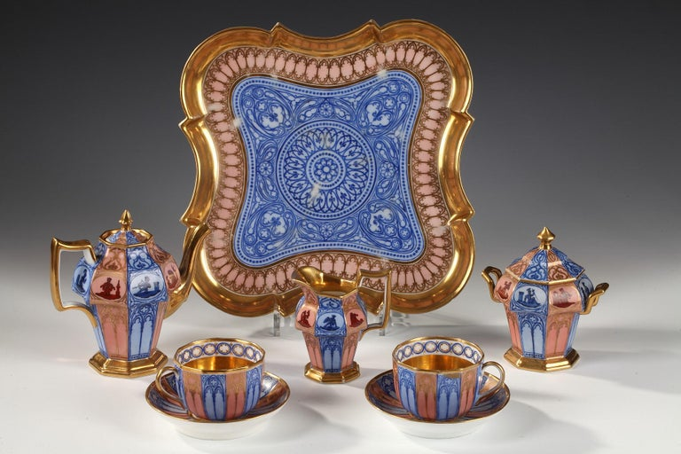 "Marked Gailliard / Passage de l'Opéra.  A very charming Paris porcelain tea set for two, called ""tête-à-tête"", with a quadrilobate tray, a pair of cups and saucers, a sugar basin, a milk jug and a teapot. This is a bevelled corners Gothic Revival"