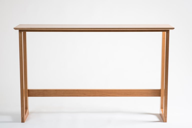 The Westport Pub table is a simple, sturdy table that would sit well in a house or apartment, as a standing desk behind a couch or as a breakfast bar by a kitchen window. The leg design plays on the traditional miter with varying angles and widths.