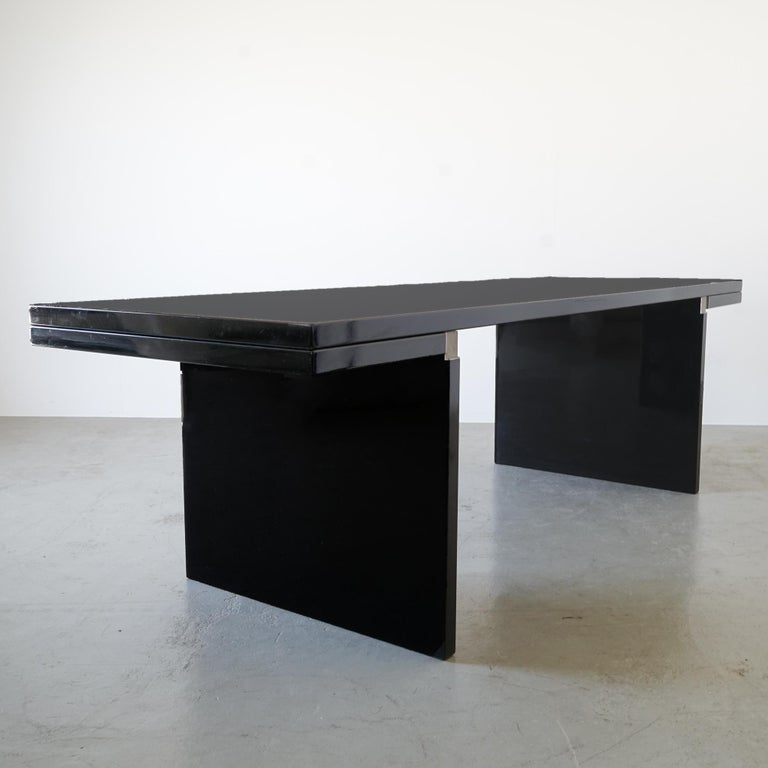 This sculptural-looking furniture Classic by Italian designer, architect and artist Carlo Scarpa was produced, circa 1972-1973 as part of the Simon Collezione by Cassina. The classically formal table, in which the formal language of geometry