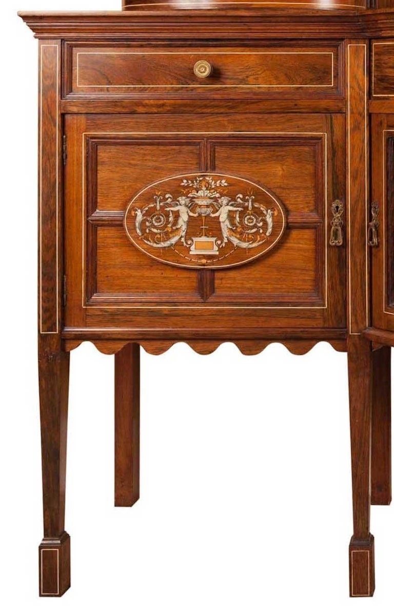 Highly decorated rosewood cabinet dresser.