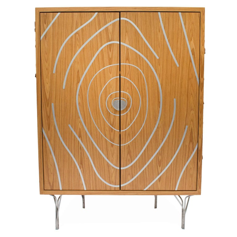 This contemporary style cabinet is part of the Tronco collection, for the purpose of representing the shape of a sliced tree, referring to the trunk. All their search for formats depart from nature, from the represented veins to the branches made of