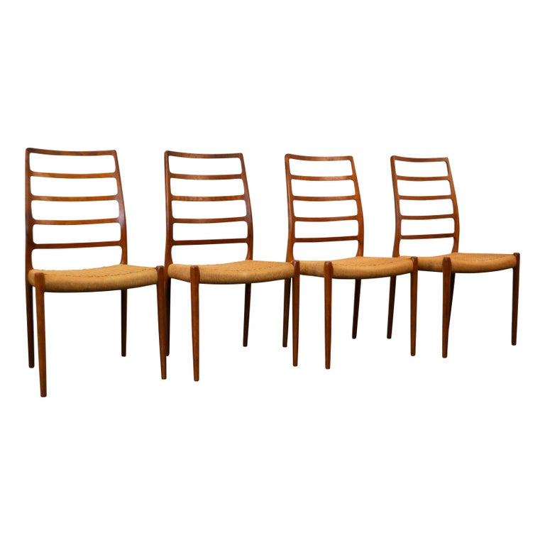 Rare set of four vintage Danish modern model #82 dining chairs designed by Niels O. Møller for J.L. Møller. Model 82 is one of Møller's rarest and most elegant designs. This stunning Mid-Century Modern design features a gorgeous typical Danish