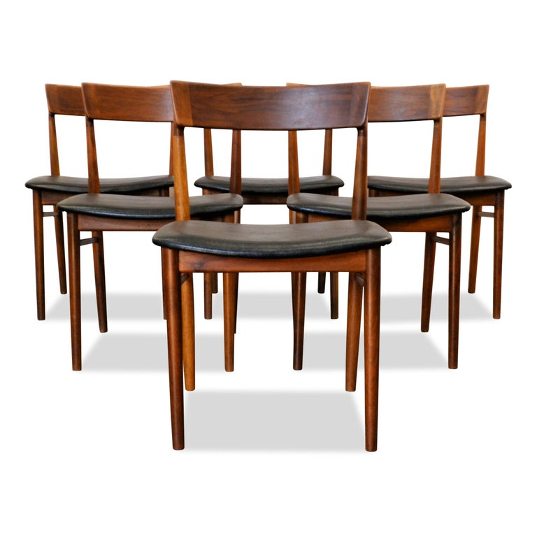 Set of six Danish vintage chairs designed by Henri Rosengren for Brande Møbelindustri. These stylish, high quality design chairs feature a typically Danish organic design, solid teak frames and a beautiful new black skai leather upholstery and new