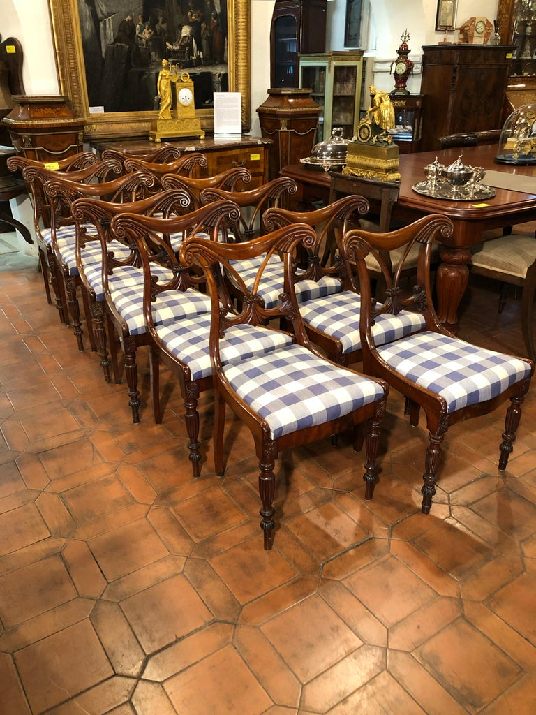 A rare set of twelve chairs, Regency period, in mahogany. In good condition but to be restored.
