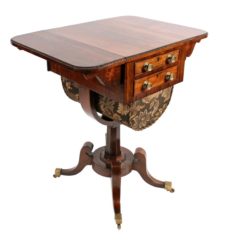 An early 19th century Regency rosewood drop-leaf lady's work or sowing table.