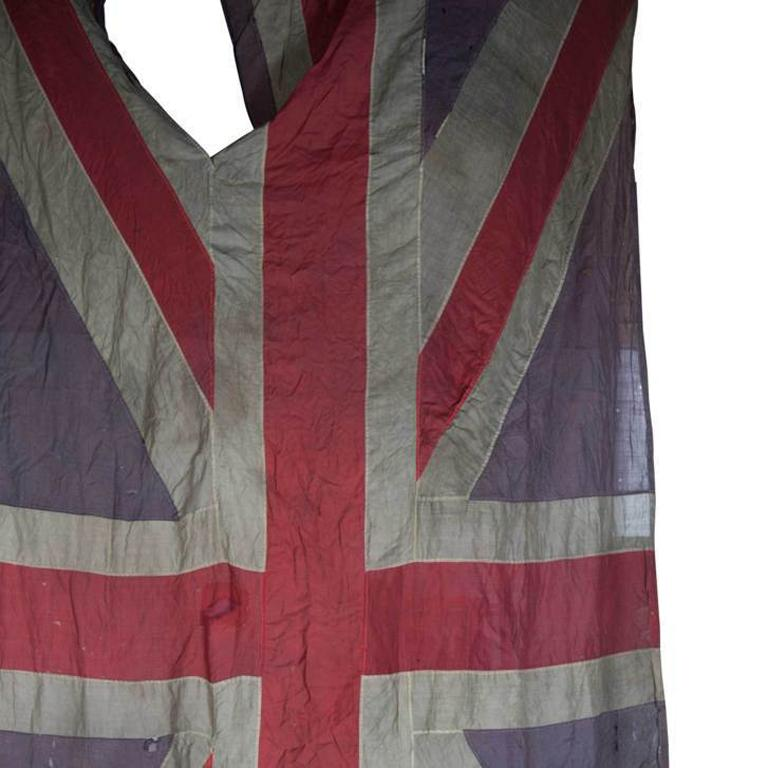A large and wonderfully distressed 19th century Union Jack flag. Partially hand stitched with period repairs, age related damage and service wear throughout.  Measurements are approximate. Free Worldwide shipping.