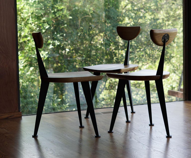 The Los Gatos dining chair was inspired by a favorite client who didn't want his dining set to block too much of his gorgeous view. Taking cues from mid-century masters like Jean Prouve, we designed a chair with a minimum of structure: two steel