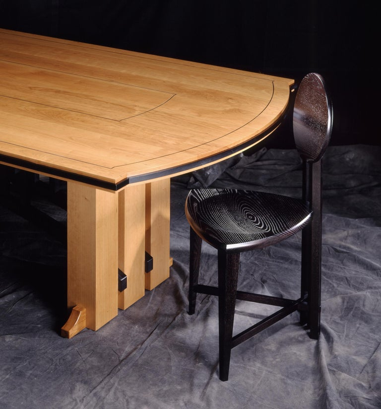 Named after the famous Gramercy Tavern Restaurant in NYC, a table like this resides in the private dining room at the restaurant. The design of this table or desk is well suited in large scale with rectangular, racetrack and boat-shape tops