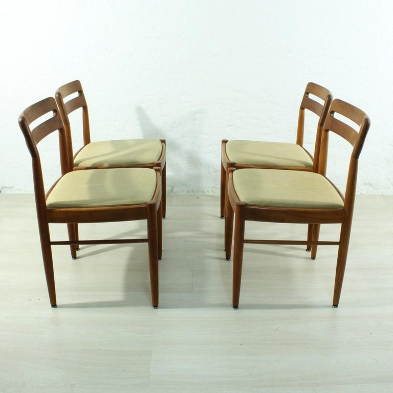 Material: Teak, fabric. Good used condition, slight discoloration in the fabric (see photos), can be easily obtained new, as seat cushion element is easy to unscrew Measures: Seat height 45cm.