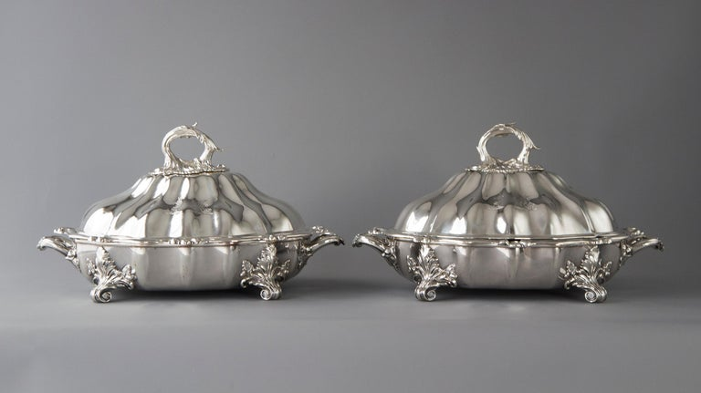 This superb pair of vegetable tureens or entree dishes are of shaped, raised and fluted lobed form, surmounted with a removable acanthus final.