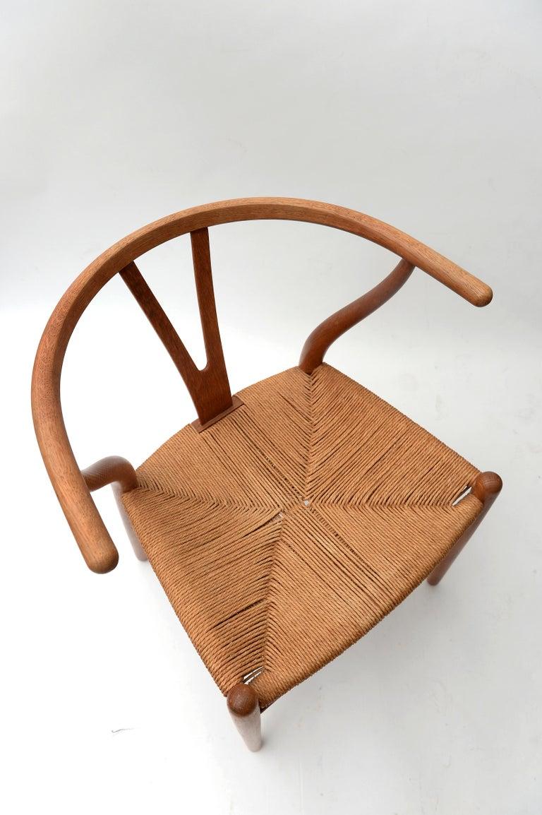 Danish Vintage Hans Wegner Wishbone Chair and a Jorgen Baekmark Stool, 1960s For Sale