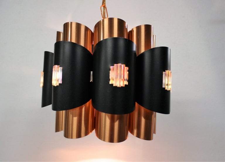 Midcentury scandinavian tubular design pendant light made from copper.
