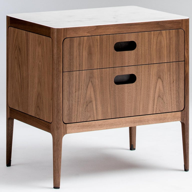 This modern walnut side table or nightstand fits beautifully with both traditional and contemporary designs. We've started with our signature table design and added two drawers to create a functional living room sofa side table, nightstand, or
