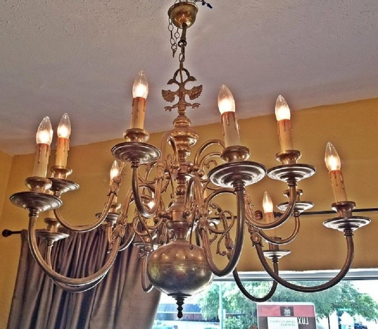 Beautiful Dutch Baroque brass chandelier-large size.  Two-tier chandelier.  12 Branches with turned arms. Each arm or branch is decorated with a double tulip.  Each branch ends with candle holder sockets.  The Chandelier ends with large ball