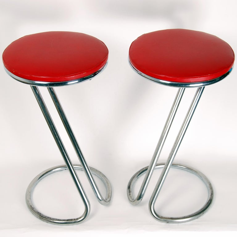 This set of two tubular steel stools was produced by DS Stålrörsmöbler in Malmö, Sweden. It comes with original red faux leather upholstery and are in very good vintage condition.