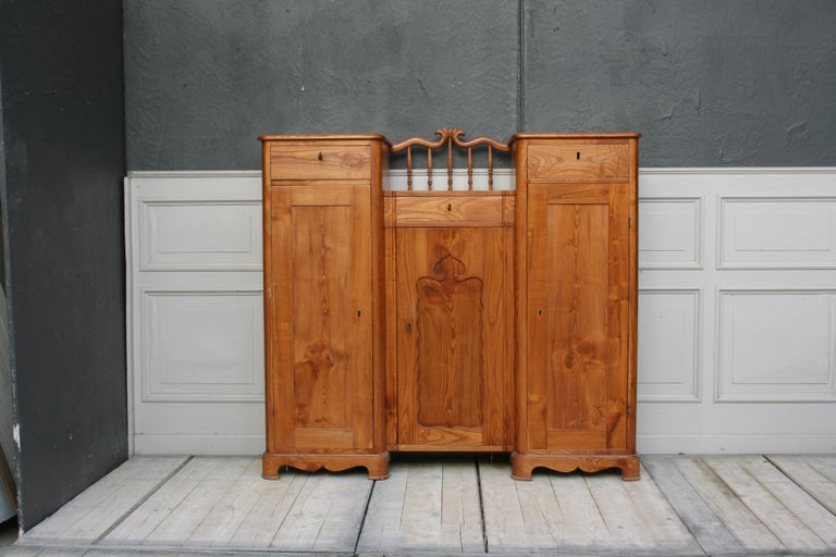 Swedish sideboard made of ash and pinewood. 3 lockable drawers and 3 lockable doors with a continuous shelf. Very massive and professional construction. Impressively smooth surface of solid ash, circa from 1900.  Dimensions: 142 cm high, 152 cm