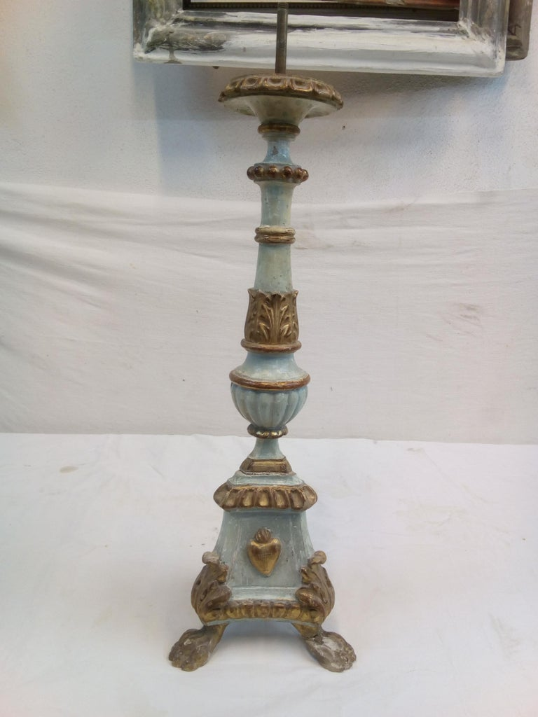 Description: Front size 18th century Italian wood candelabra of order of the sacred heart . Feet with a lion's paw in gilded wood. The base is carved with gilded wood leaf motif. Body is painted with lacquer colored heavenly with coat of arms of