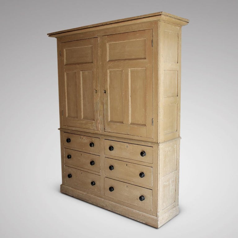 A wonderful, large, early 19th century Estate or housekeepers cupboard with lovely panelled sides. The exterior and back of the doors dry scraped back to their original paint, the interior retaining its original paint,