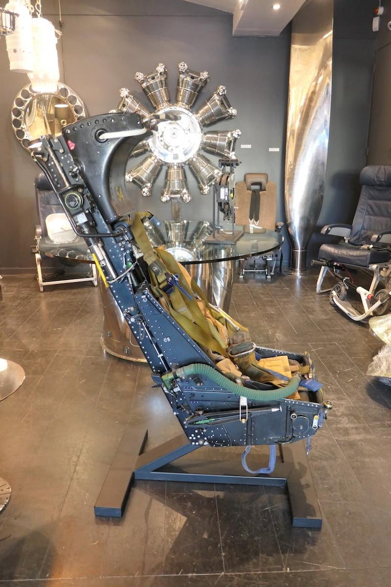 Authentic Aircraft Martin Baker MK5 ejection seat put into service in 1957. The seat is mounted on a pedestal presented in black paint finish. Very rare item. These seats were installed on McDonnell Douglas F-4 Phantom, Grumman 6 intruder, Vought F8