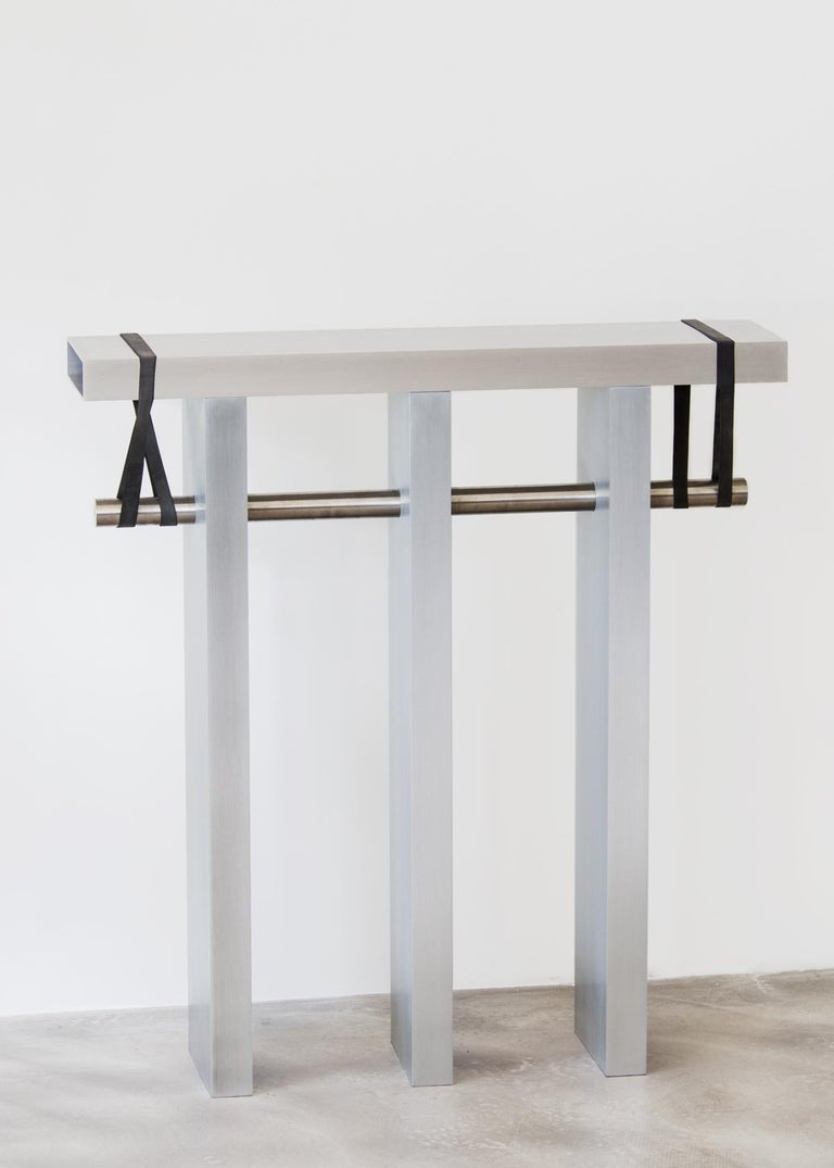 Arke is a console composed only of Industrial elements. It consists of four (or more) brushed and anodized aluminium profiles standing together with the help of a polished stainless steel rod and two black rubber bands. Arke uses the resources