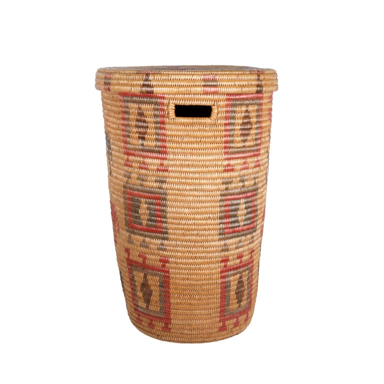 """Jicarilla Apache lidded waste basket with handle cut-out, quadrupeds (we think dogs), and geometric designs. Acquired by Charles Graves, Indian agent in the 1920s. New Mexico. Slightly faded on outside but not distracting. Measures: 14"""" D x"""