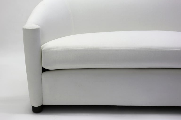 American Curved Sofa with Scroll Arms and Loose Seat Cushion with Wrap around Wood Legs For Sale