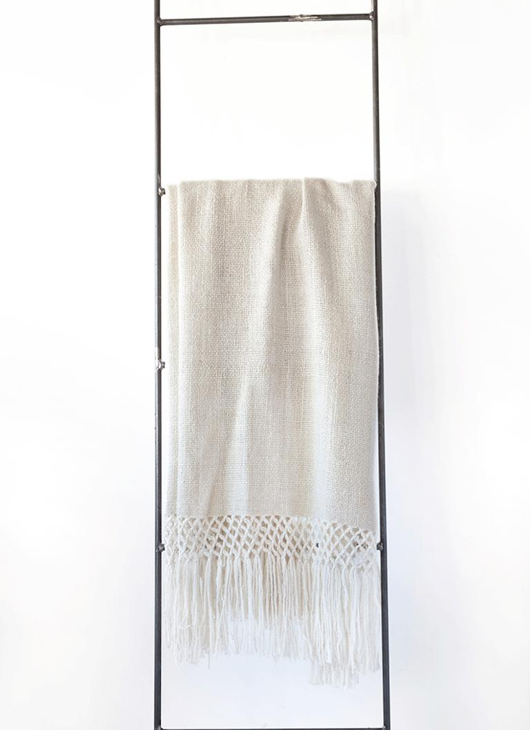 We love this elegant, super soft throw. Woven by hand by master weavers living in remote areas of La Puna, Argentina, using ancestral techniques. They are made of pure virgen llama wool, carded and spun by hand. The entire process, from shearing to