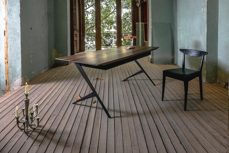 The Mantis desk has a striking painted steel base and a polished and angular desktop. The Mantis design is borne from a study of bio mimicking - inspired by how nature creates structures with joints and intersections, imagining trees, the human