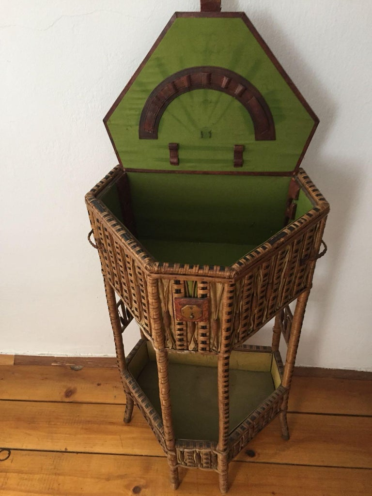 This is a very special and rare piece:  This sewing table is from turn of the century. Prag Rudniker was a famous wicker manufacturer, originally from Vienna, Austria, Prag Czechoslovakia and Bukarest, Rumania. One of its students was the famous