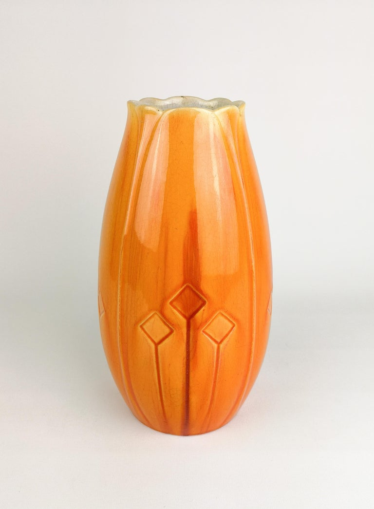 Nicely glazed Art Nouveau vase designed by Alf Wallander for Rörstrand Sweden. The glaze has a wonderful red/orange shine. The vase have some distress marks allaround from its age.
