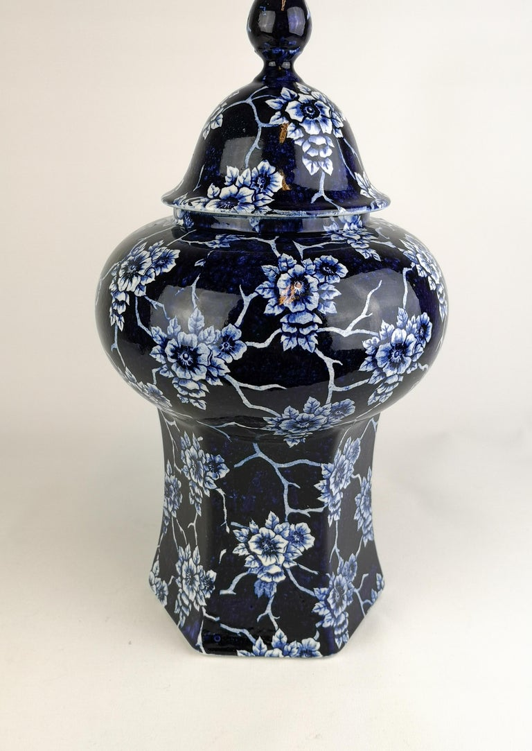 This vase is beautiful sculptured, and its blue deep color gives the flower pattern life. It was made in the early 1900s for Rörstrand Sweden.  The vas is in very good condition considering its age.