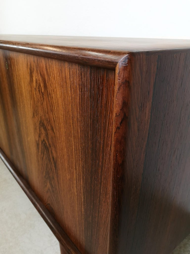 Sideboard in rosewood by Norwegian designer Torbjørn Afdal by Nejestranda Møbelfabrik for Bruksbo. This sideboard is a very high-quality piece with lovely crafts details with curved short ends on the doors and brass key holes. It's not often to be