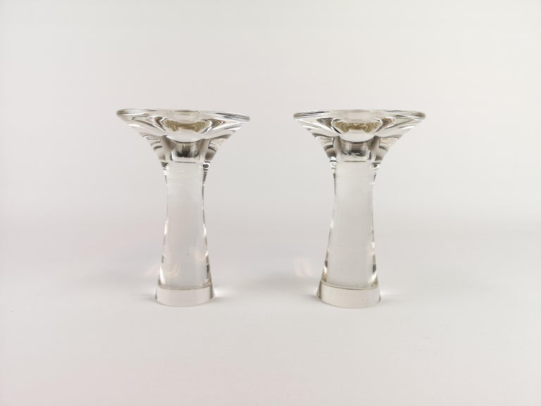 The glass candlesticks designed by Tapio Wirkkala is called Model 3412. The object is a classic manufactured by the Finnish workshop Iittala. The pieces is from the 1960s and signed on the bottom